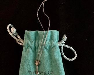 $50 Tiffany Sterling silver youth necklace with key pendant.