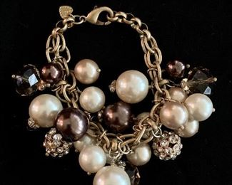 $25 Fashion bracelet with faux glass, pearl and rhinestone baubles.