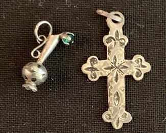 $20 Lot of 2 Sterling silver charms.  Embellished urn (left) and etched cross (right - stamped 925)