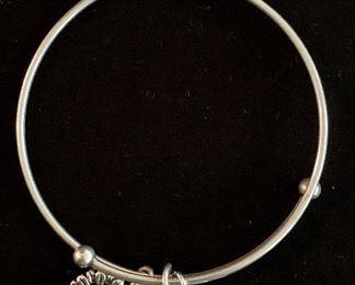 $20 Alex & Ani bracelet with three charms.