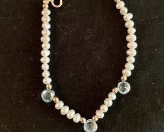 $20 Child's fresh water pearl bracelet with three light blue briolettes and six gold beads.  Clasp marked 14K.