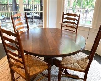 4ft round table with 4 rush seat ladder-back chairs