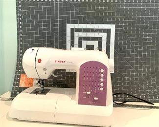 "Singer ""Curvy"" sewing machine."