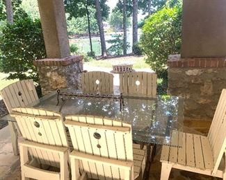 Outdoor glass top table and six wood chairs