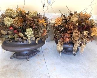 oversized dried flower arrangements in extremely heavy iron pots