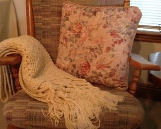 One of two matching gliders, hand croucheted Afghan and one of many decorative pillows