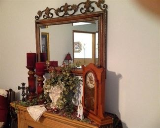 Decorative mirror, antique oak mantel clock (has the key), large candle holders, crosses, hankie, floral
