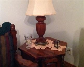 Octagonal table, hand crocheted doilies, candle holders