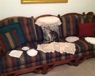 Sofa, pillows and doilies