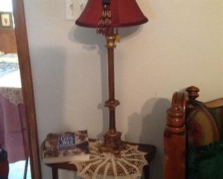 Antique Demi- table, hand croucheted doily, lamp, and books
