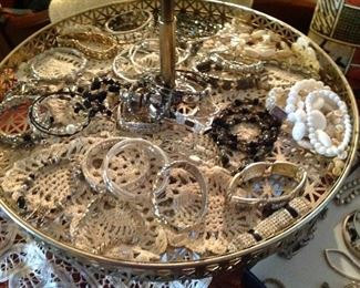 Rotating large tray full of doilies and jewlery