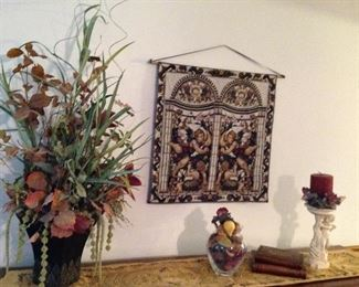 Tapestry, table runner, floral arrangement, faux book boxes, cherub candleholder with florals