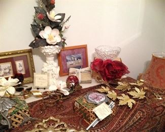 Wind chimes, cherub planter and magnolia arrangement, ruby rose bowl, metal leaf wall art