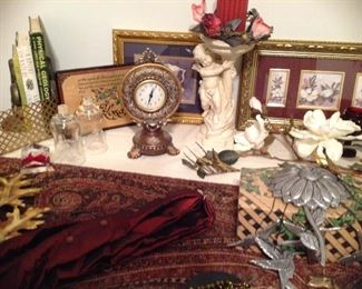 Decorative clock, fleur de Lis bookends, vintage metal shelf, decorative leaves, cherub planter with florals and windchime