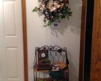 Wreath, shelving unit, mini chest with clock, decorative items