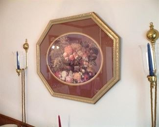 Framed and matted print, brass sconces with glass globes, beaded tassels