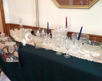 Table runners, battenburg tablerunners, crystal bowls, Wexford decanter and stems set, vintage candleholders, large crystal biscuit barrel with lid and more