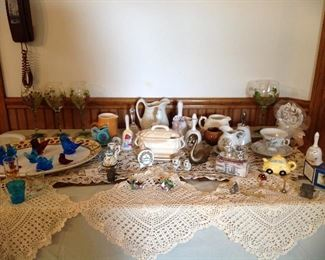 Table runner, croucheted doilies, large platter, blue bird and red bird collection, hand painted grape wine glasses, mini tureen with ladle, 25th anniversary collection, creamer collection, jigger collection, Mini pewter collection