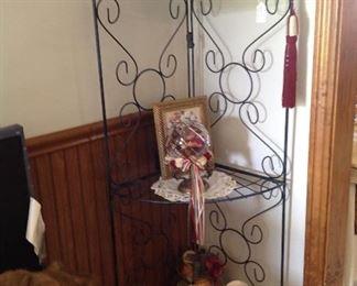 Corner folding metal shelving unit, decorative items and doilies