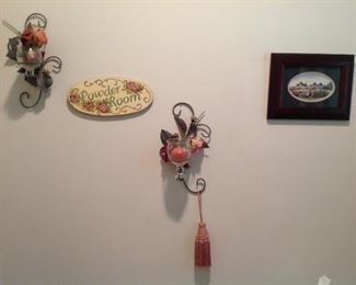 Framed Catherine Karen's Mann print, decorative sconces with candles and florals, powder room plaque