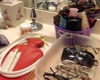Vintage hot water bottle in original box, reading glasses