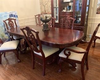 unique beautiful dining table with matching buffet table and hutchby Graebel