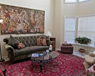 ASIAN RUG, METAL AN D GLASS COFFEE TABLE VELVET TUFTER SOFA, TORCHE` LAMP, FRENCH TAPESTRY, UPHOLSTERED FOOT REST