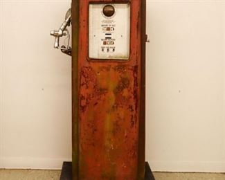 """Lot 5: Mid 20th century Tokheim model 39 short gas pump, serial  #821989-10-39. Original condition with interior mechanical parts. Overall paint loss and surface rust. Lacks glass, hose, and globe. 59"""" high."""