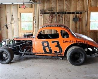 Lot 1: 1970s open wheel stock car from Rudy's Garage, New York. Built from a 1937 Chevy 5-window coupe body, a Mike Butler racing small block Chevy V-8 engine, 2BBL carburetor, manual transmission and 4 -wheel drum brakes. Winters Quick Change Rear End, Hoosier dirt track tires. Starts and runs well. Includes an extra set of dirt track Hoosiers and wheels in good condition.