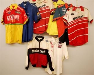 Lot 12: Eight 1980s-90s race crew shirts. Short sleeves with various sponsor logos. Some wear. Size Medium and Large.