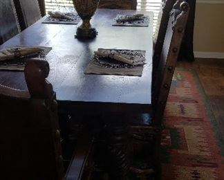 """Measurements of dining table 86"""" long, 41"""" wide.  The chairs are approximately 42"""" tall.  Front of chairs are leather with reproduction Spanish brads/coins.  SOLID WOOD"""