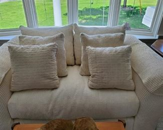 Custom cream love seat/small sofa with pillows