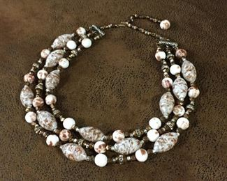 """Beautiful triple-strand necklace with vintage oblong and round shaped Venetian glass beads and clear and bronze-colored faceted spacer beads. Flexible length from 14 1/2""""-17 1/2"""". $68"""
