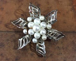 """Pretty flower/pinwheel-shaped silver brooch with a cluster of genuine pearls in the center. 1 7/8"""" diameter, stamped SILVER.  $60"""