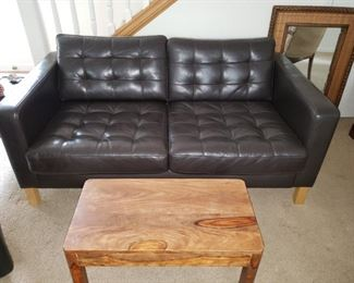 Contemporary Leather Black leather Sofa. Rustic Bench/Coffee Table. Mirror.