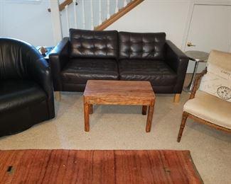Black Leather Barrel Chair. Vintage Chair. Wool Handwoven Carpet-Origin Unknown.