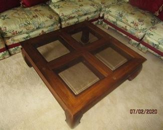 Square coffee table w/ 4 glass inserts.