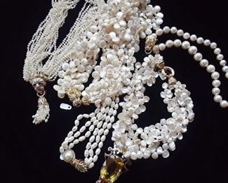 Examples of several types of fresh water pearl necklaces, including four more not shown.