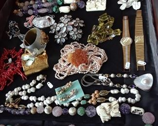 There is still a great selection of fashion jewelry in hard stones and glass, fresh water pearls, and novelty findings. 50% off case. Some jewelry will not be discounted.