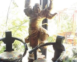 Temple guardian statue is almost lifesize. Bar stools remain with the house which has been sold.