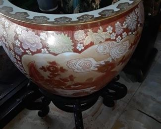 One of several differet large fish bowls used as planters