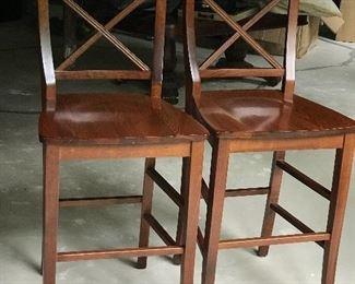 Pir of wooden bar stools