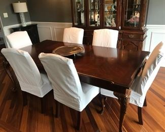 Walter E Smithe table, 2 leafs, pads, 6 chairs - original gold upholstery under slip covers in excellent condition!