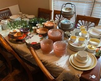 Front room:  Large dining room table with leaf and 8 chairs, seven sets of dishes