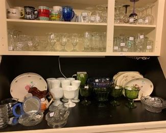 Kitchen: Ice Cream dishes, cups, stemmed glasses, drinking glasses, juicers, platters, milk glass, Indiana glass bowls, vases, and compotes.