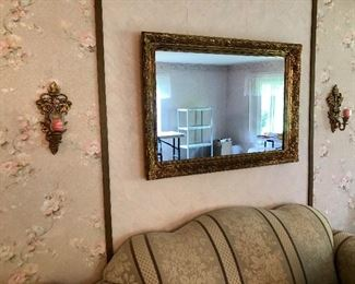 Couch and wall hanging mirror