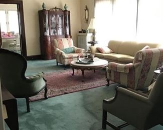 Overall of Living a Room with Vintage Sofa, Club Chairs And various items from art, accessories and furniture.
