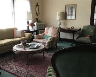 Second overall view of the living room including a mahogany stand with drop sides, table lamps, area rug and other great finds