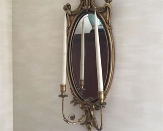 One of a pair of beautiful double light sconces with a mirror backplate by F B Decorators Art Inc.