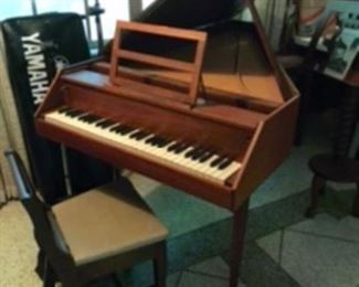 Harpichord piano & chair by Zuchermann need some work. But have all pieces to assemble & manual. We are taking silent bids on this item
